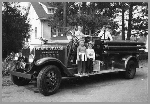 Photo of youngsters on muster truck around 1960