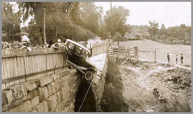 Photo of a Model T teetering on bridge